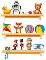 Viele Spielsachen auf hölzernen Regalen vektor
