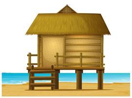 Trä bungalow på stranden vektor