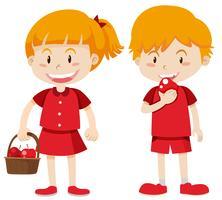 Junge und Mädchen in roten Äpfeln essen vektor