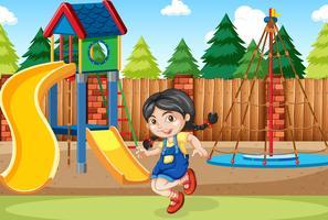 En tjej på lekplatsen