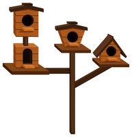 Vier Vogelhäuschen an einer Stange