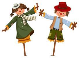 Scarecrows klädd som tjej och pojke