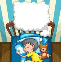 Liten pojke i gula pyjamas sover