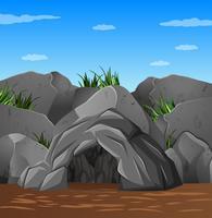 Bakgrundsscen med grotta och blå himmel