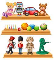 Verschiedene Puppen und Bälle in Regalen