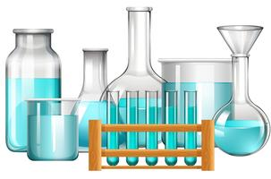 Glasbägare och provrör med blå vätska