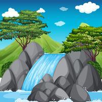 Vattenfall scen med stora berg i bakgrunden