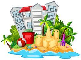Sommar tema med sandslott på stranden