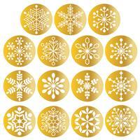 weiße Schneeflocken auf metallischen Goldkreisen