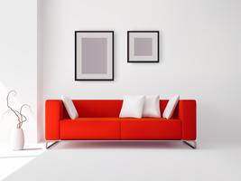 Röd soffa med kuddar och ramar
