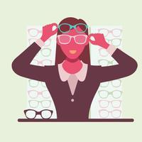 Ung kvinna försöker sina nya glasögon