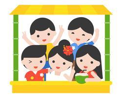 Glückliche Menschen mit thailändischem Sommerkostüm im Bambusstall