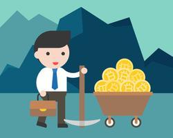 Affärsman håller en pickaxe med bitcoin i pengar vagn