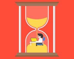 Affärsman som arbetar på skrivbordet i timglas, tidskoncept