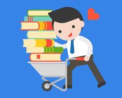Affärsman bär en hög med bok med kundvagn, världsbokdagkoncept