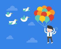 Der Geschäftsmann, der mit Ballon im Himmel fliegt, ängstliche Vögel stoßen seinen Ballon