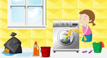Tjej gör tvätt i rummet