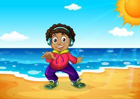 En pojke på stranden