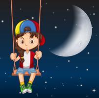 Junge auf Schaukel nachts vektor