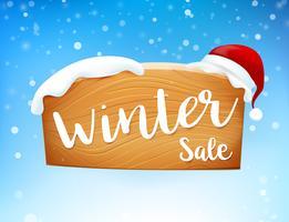 Winterschlussverkauf auf Holzschild und Schneefall 001