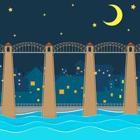 Bro över staden på natten