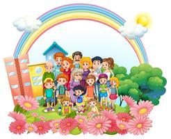 Familjemedlemmar står i trädgården