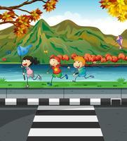 Tre barn leker på trottoaren vektor