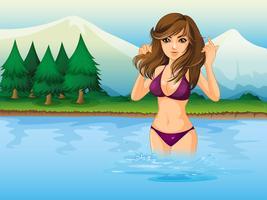 Ein Strand mit einem Mädchen, das einen lila Bikini trägt
