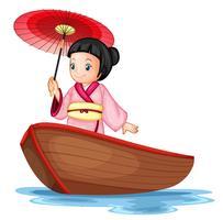 En japansk tjej på träbåt