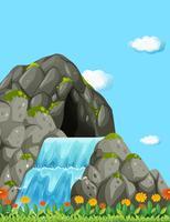 Scen med vattenfall och fält
