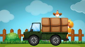 Lastbil lastad med hö på gården