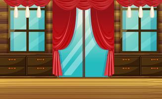 Zimmer mit Holzmöbeln und rotem Vorhang