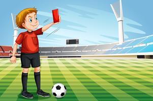 Schiedsrichter, der rote Karte im Fußballplatz zeigt vektor