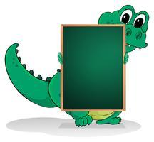 En liten krokodil på baksidan av en tom greenboard