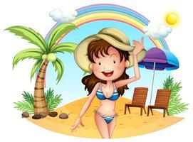 En tjej i baddräkten på stranden vektor