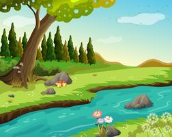 Ein Fluss am Wald