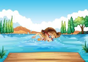 En tjej som övar att simma