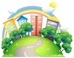 De höga byggnaderna och regnbågen