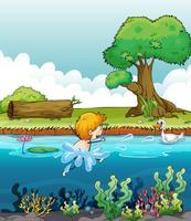 Ein Junge, der mit einer Ente im Fluss schwimmt