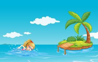 Ein Mädchen, das nahe einer Insel mit einem Kokosnussbaum schwimmt