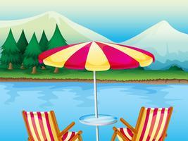 Ett strandparaply med stolar