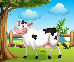 En ko i bakgården vektor