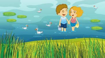 Ein Mädchen und ein Junge im Teich vektor