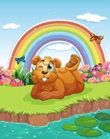 En björn vid flodbredden vektor