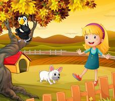 En tjej med en hund och en fågel