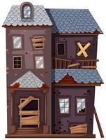 Förstört hus med trasiga fönster och dörr