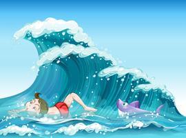En pojke som badar med en haj på baksidan
