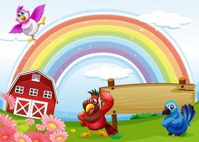 Vögel auf dem Bauernhof mit einem Regenbogen und einem leeren Schild