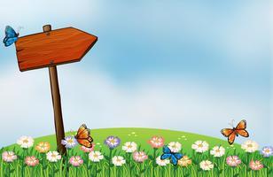 Ein Pfeilschild und die Schmetterlinge