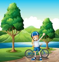 En ung kvinnlig cyklist som står nära floden vektor